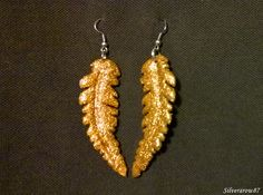 Golden feather - Yes! A handmade trinket again. XD