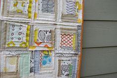 Improv log cabin quilt  Mostly neutrals + citron + orange prints  + aqua prints