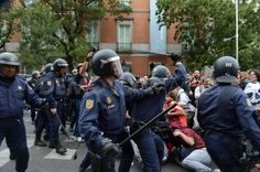 Protesters and riot police wielding batons seen here as they clash near the Spanish parliament during renewed demonstrations over austerity measures.