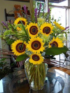 Summer Arrangement by Texas Blooms (sunflowers, purple liatris, green spider mums, bells of ireland)