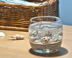 Gel candles that capture sand and shells and the feeling of water.