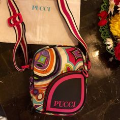 EMILIO PUCCI Satin Leather Rubber DESIGNER HANDBAG EMILIO PUCCI DESIGNER Logo Shoulder Bag HANDBAG ~Made in ITALY ~gorgeous , colorful , unique, AUTHENTIC & RARE ~Genuine Calf Leather trim , famous & internationally recognizable PUCCI printed bag is made of Satin , straps are thick&woven, Rubber details such as PUCCI logo pocket & zipper pulls ~ Pink buckle is imprinted w PUCCI  &allows straps to adjust ~ small / medium sized bag is the PERFECT fun & fashion-forward bag & right size for all…