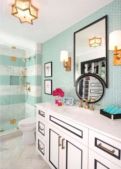 Loving the sea green striped tiles in this beachy bathroom.