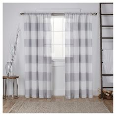 • 100% polyester                                                                                                                                                                   <br>• Sewn-in rod pocket for easy hanging<br><br>Bold tone-on-tone horizontal stripes make a big impact with this Set of 2 Darma Window Curtain Panels that are semi-sheer. As functional as fashionable, they give you the privacy you're after and also let the natural light into y...