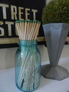 The long matches in a box were less than $2 at grocery store -- and you just cut the striker out & tape/glue to bottom. Can be done with any vase!