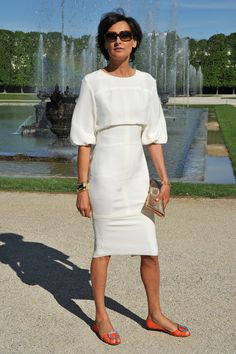 Ines de la Fressange in the dress with flats, from another angle.