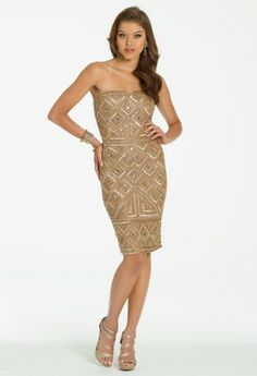 Geometric pattern and plush coloration make this short cocktail dress and absolute winner for this season! Whether it's worn as an amazing holiday dress, homecoming dress, or guest of wedding ensemble this stunner is sure to make you look and feel fabulous! A strapless design, this full glamor short dress defines an empire waist and showcases every curve amazingly. Personalize this outfit with exclusive extras like a shimmer sparkle box handbag, heavy rhinestone stretch bracelet, and a high ...