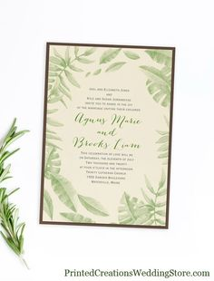 Jungle Love Invitation - luscious tropical greenery adorn this invitation card.  A truly custom look comes with your choice of ink colors.  Three different looks for this same invitation design...the card by itself, with a colored backer, or with a colored pocket. See this design and many more greenery wedding invitations at www.PrintedCreationsWeddingStore.com.