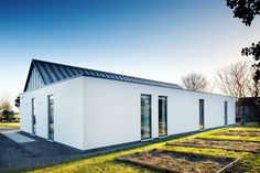 The demolition of a post-war bungalow leads to a bright, minimalist eco family home under in Aberdeenshire. Bungalow Exterior, Bungalow House Design, Modern Bungalow, Bungalow Extensions, Small Modern House Plans, Self Build Houses, Ireland Homes, Building A House, Building Ideas