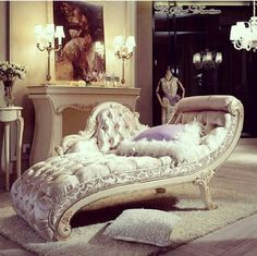 White Victorian Boroque French chaise lounge in white in a luxury interior setting