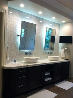 Master Bathroom With Glass Backsplash, Walnut Cabinets, And LED Backlit  Mirrors