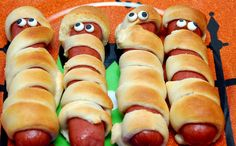 SUPER EASY! WRAP PILLSBURY CRESCENT ROLLS AROUND HOT DOGS. BAKE ACCORDING TO THE PACKAGE DIRECTIONS. I BOUGHT CANDY EYES AND ATTACHED WITH MUSTARD!   You May Love These, Too! XOXOPILLSBURY CRESCENT ROLLS STUFFED WITH MINI MILKYWAYSMummy PretzelsHALLOWEEN EVE!LEFT OVER HALLOWEEN CANDY