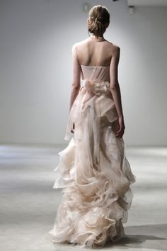 I have never seen ruffles draped so beautifully.  I don't typically like them, but these are stunning...