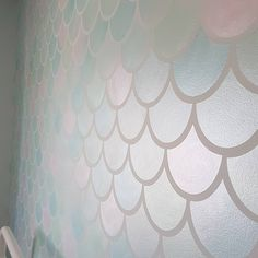 Swipe to see the gorgeous shimmer of the mermaid scales 😍 Link in bio to sten. ♡ Swipe to see the gorgeous shimmer of the mermaid scales 😍 Link in bio to stenciled wall how-to!