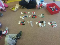 Letters with lids in the Sr. Preschool room at the Sunflower School, Orangeville