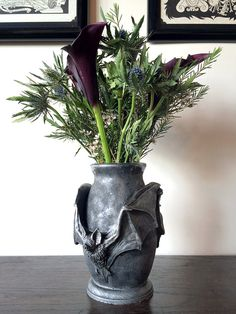 """Bat Vase By: Dellamorte & Co.  Sculpture of a pair of vampire bats on a vase, cast in resin and hand painted. -7.5"""" tall"""