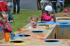 cardboard playground fun :: my girls would absolutely love painting a masterpiece on this!