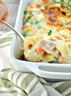 Cheese tortellini are baked in a creamy, cheesy sauce for an easy and delicious weeknight dinner! This Chicken and Veggie Tortellini Casserole is a family-friendly way to get a wholesome and comforting one dish meal on the table fast!