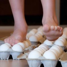 Walking on Eggs is a great science experiment to explore and discuss. put a plastic trash bag under carton of eggs just in case. Try to make your foot as flat as possible. Place the ball of your foot between the two rooms of Eggs. You will be amazed how strong the eggs are. Have fun