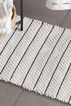 No one wants to get out of the shower and step out onto a cold floor! Set your tootsies up for comfort with this stylish and practical taupe bath mat. With a super absorbent nubly texture, it'll add interest to your bathroom's 5th wall - the floor! Made from 100% cotton, it's machine washable - pretty important for something that lives in a high-moisture area. We've really thought of everything! Mason Jar Tumbler, Mason Jar Soap Dispenser, Wood Wall Shelf, Bathroom Collections, Rattan, Laundry Room, Bath Mat, Taupe, Floor