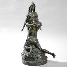 A French Art Nouveau patinated bronze sculpture by Théodore Rivière, featuring two intricately-sculpted figures from the story of Carthage. The woman has emerald eyes and her crown is accented with rubies. (Item No.: 782) Dimensions: 7'' diameter x 16'' high Artist or Maker: Riviere Date: 1900.