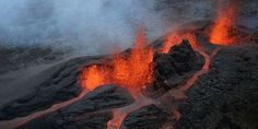 A picture taken on May 2016 on the French island of La Reunion shows lava during the eruption of the Piton de la Fournaise volcano, in an uninhabited area. The Atlantic Volcan Reunion, Lava Flow, Photos Of The Week, Photos Du, Amazing Nature, Geology, The Good Place, Island, Instagram Posts