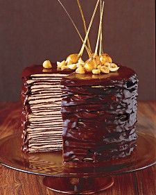 Darkest Chocolate Crepe Cake-The decorative nuts are dipped in caramelized sugar and hung upside down so the sugar streams and hardens into the best candy on the block.