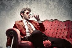 Picture of Young man sitting on a sofa and drinking a glass of wine stock photo, images and stock photography. Wine Photography, Al Capone, Man Sitting, How To Become Rich, Rich People, Rich Man, Inspirational Videos, Wine Drinks, Dressing