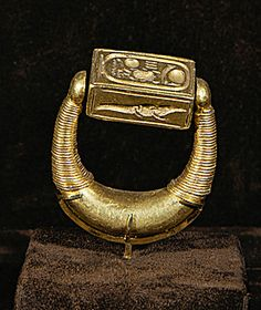 EGYPT JEWELRY 2ND-1ST MILL.BCE  Gold seal ring of Pharaoh Horemheb, commander-in-chief under Amenophis IV (1365-1347 BCE), then Pharaoh (1332-1305 BCE) during the restauration period at the the beginning of 19th Dynasty, New Kingdom, Egypt.