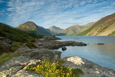 The outline of the three peaks of Lingmell, Scafell Pike, and Great Gable provide the backdrop for the waters of Wast Water.