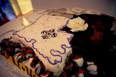 Grooms Cake from Ambrosia Bakery: Strawberry cake as Louisiana, Chocolate ganache as Mississippi!  And of course, some LSU in there.