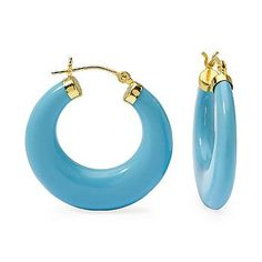 Brilliant blue turquoise hoops taper to meet at 14kt yellow gold snap-bars. >>Click on the hoops to browse our Turquoise jewelry collection. #hoops #earrings #turquoise