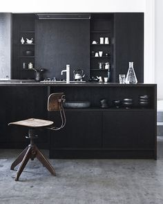 (Now that's a) black kitchen.  educate your sofa: We could live in a kitchen.