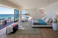 Chambre à coucher avec panorama splendide vers le littoral et l'eau