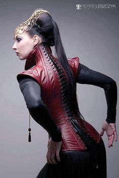 Beautiful woman in red leather corset vest with high neck collar