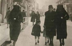 A Muslim woman covers the yellow star of her Jewish neighbour with her veil to protect her from prosecution. Sarajevo, former Yugoslavia. [1941]