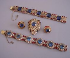 HOBE red, blue and clear rhinestones set in gold tone filigree bracelets, brooch and earrings