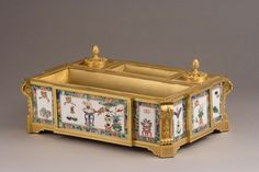 Louis XVI style inkstand with an ormolu mount and two inkwells with a pine cone shaped lid. The sides are decorated with twelve Chinese green family porcelain plates. Attributed to...Samson & co 1860