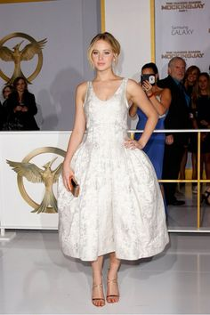 Jennifer Lawrence in a gorgeous midi jacquard Dior dress at the LA premiere of The Hunger Games: Mockingjay