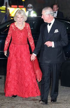 Camilla, Duchess of Cornwall smiled for the cameras upon arriving at London's Hammersmith Apollo in a glamorous red lace gown, as Prince Charles, dashing in a tux, looked proudly on.