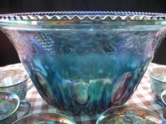 I have this carnival glass punch bowl and cups in green