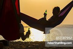 Relaxing In Hammock at sunset time.West Sumbawa.Indonesia.