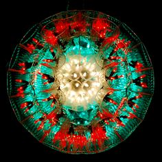 A mini within a hard cup sparkleball by Carl Boro.
