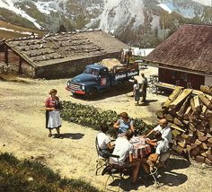 Café Alpenblick Opel Blitz  Alpine vacation in the fifties. Then: a truckload of refreshmenst for four visiting tourists. The scene would now show us about 43 tourists here, and a Fraulein with a handheld computer.