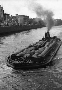 The barge, Castlenock, sails down the River Liffey with hogsheads of Guinness stout. Photograph by David E. Scherman for Life magazine. Dublin Ireland, Ireland Travel, Old Pictures, Old Photos, Guinness Ireland, Barge Boat, Down The River, Dublin City, Ireland