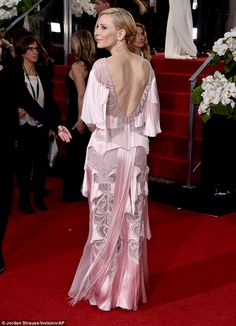 Daring: Cate's dress featured a scoop back which revealed plenty of the actress's skin as she turned her back to the cameras