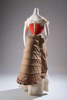Corset & Bustle: ca. 1880, wool, silk, steel, whalebone; bustle - polka dot printed cotton, steel.
