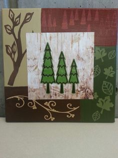 12 x 12 Trees on canvas made with Cricut images, craft paint and birch bark scrapbook paper.