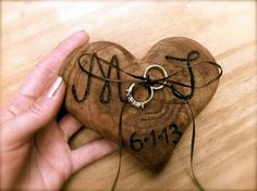 Rustic Ring Bearer Alternatives | Hand carved heart-shaped wooden ring pillow.