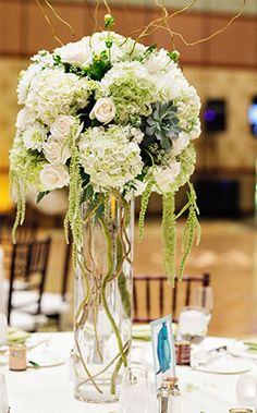 Pair your favorite greenery with variations of white and cream for a fresh, natural look at your wedding reception
